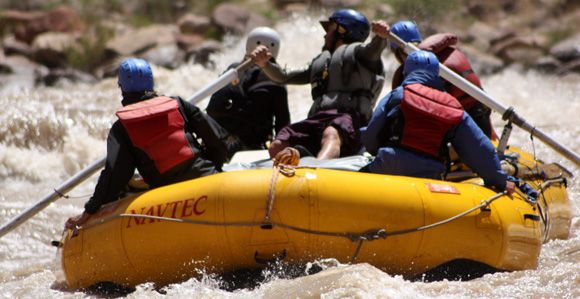 Oar raft on the Colorado River in big whitewater rapids
