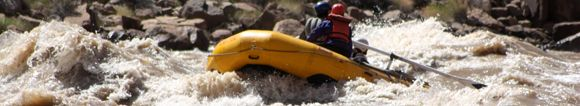 Rowboat in Big Drop Rapids Cataract Canyon Class V