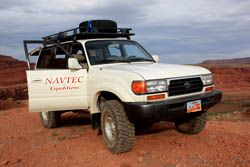 Toyota Landcruiser overlooking the Colorado River on the White Rim
